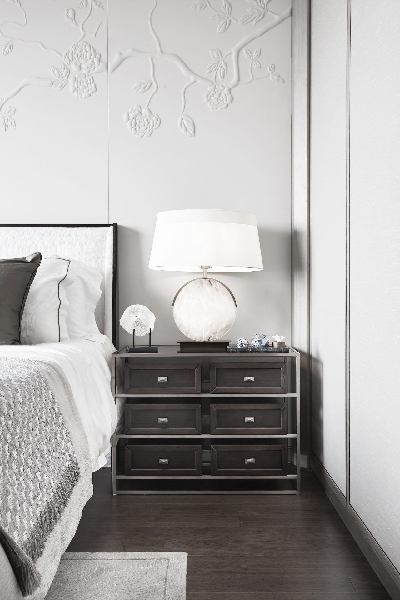 Master bedroom close up with textured wall and sideboard